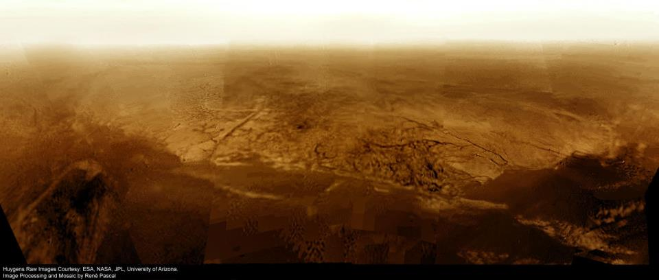 Here is a real image of Titan's surface, stitched together using images taken from the Huygen's probe, as it made its descent through Titan's atmosphere. Click the Image For More Information