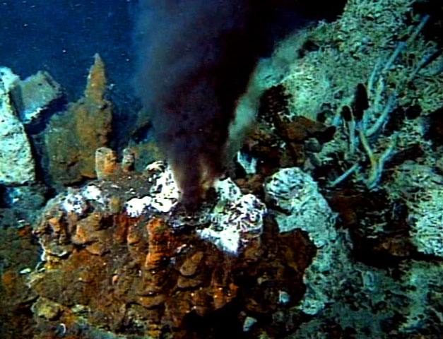 """Black smoke"" billows from hydrothermal vents on the ocean floor. (Credit: WGBH Educational Foundation)"