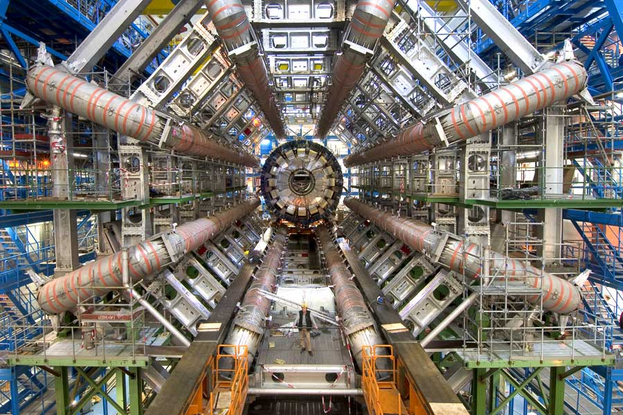The Higgs Boson was discovered at The Large Hadron Collider. For perspective on its size, see the person standing in the middle of the machine. (Credit: Maximilien Brice, CERN) (Source)