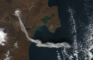 Shiveluch Volcano, on Russia's Kamchatka Peninsula, erupted on October 6, 2012, sending a plume of ash high into the air, carried first south, then east, as winds shifted. Shiveluch is one of the biggest and most active volcanoes on the Kamchatka Peninsula.