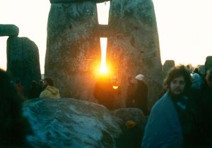Sunrise between the stones at Stonehenge on the Winter Solstice in the mid 1980s.