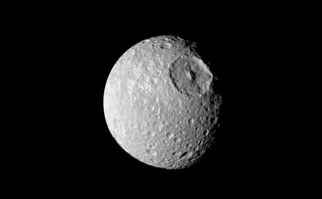 Mimas has a huge 80-mile-wide (130km) impact crater called Herschel via NASA
