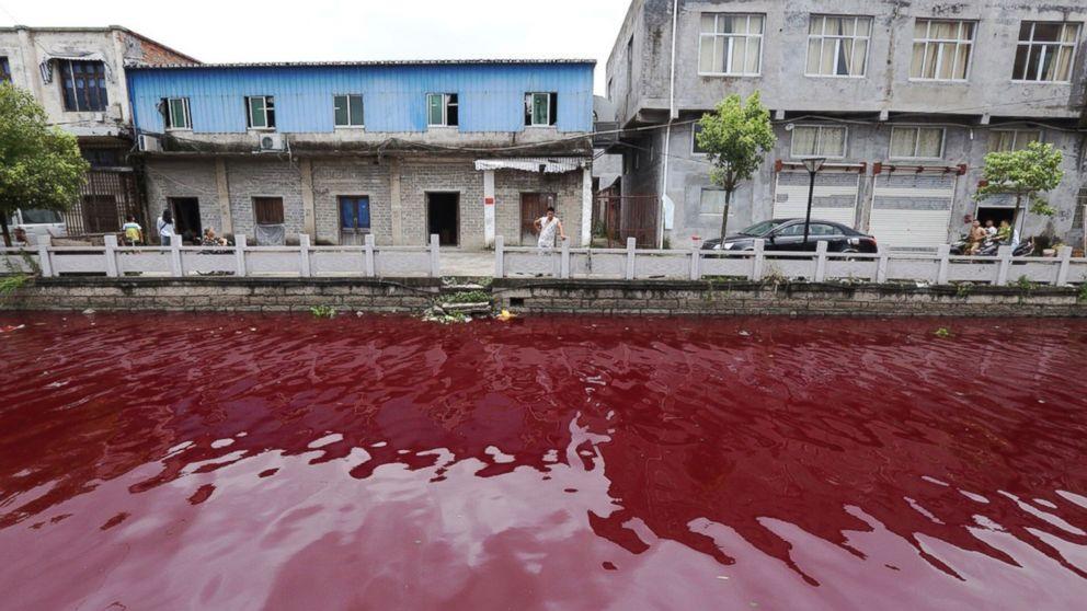 Blood river in China. Image via Newscom
