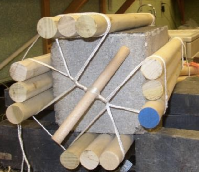The concrete block with the 12 rods attached. A second variation, with smaller diameter rods placed in the two intersection of the three larger rods also proved stable, and was successful in reducing the peak force required to start the rolling motion of the block | Image and caption credit: West, Gallagher and Waters