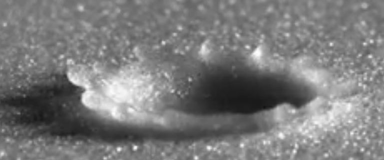 Close-up view of a raindrop falling on a granular surface, which produces effects similar to an asteroid collision (but on a much smaller scale). (Credit: Xiang Cheng, University of Minnesota et al./APS Physics via YouTube)