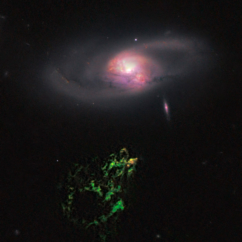 """Hanny's Voorwerp"" (green, below) is an astronomical object that has been turned off around 200,000 year ago. Visible in the upper part is the spiral galaxy IC 2497"