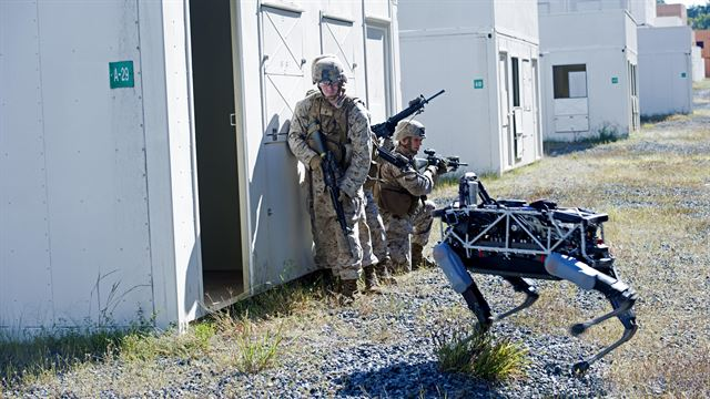 Spot, a quadruped prototype robot, aids Marines in clearing a room during a demonstration at Marine Corps Base Quantico, Va. Credit: USMC