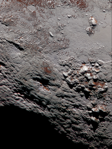 High resolution color image of Wright Mons, a potential cryovolcano on Pluto. Credit: NASA