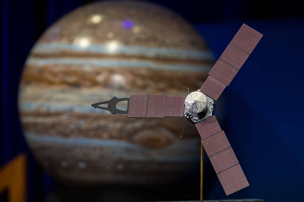 A model of the Juno spacecraft is seen at a news briefing, held before Juno enters orbit around Jupiter, on Thursday, June 30, 2016 at the Jet Propulsion Laboratory (JPL) in Pasadena, CA. The Juno mission launched August 5, 2011 and will arrive at Jupiter July 4, 2016 to orbit the planet for 20 months and collect data on the planetary core, map the magnetic field, and measure the amount of water and ammonia in the atmosphere. Photo Credit: (NASA/Aubrey Gemignani)