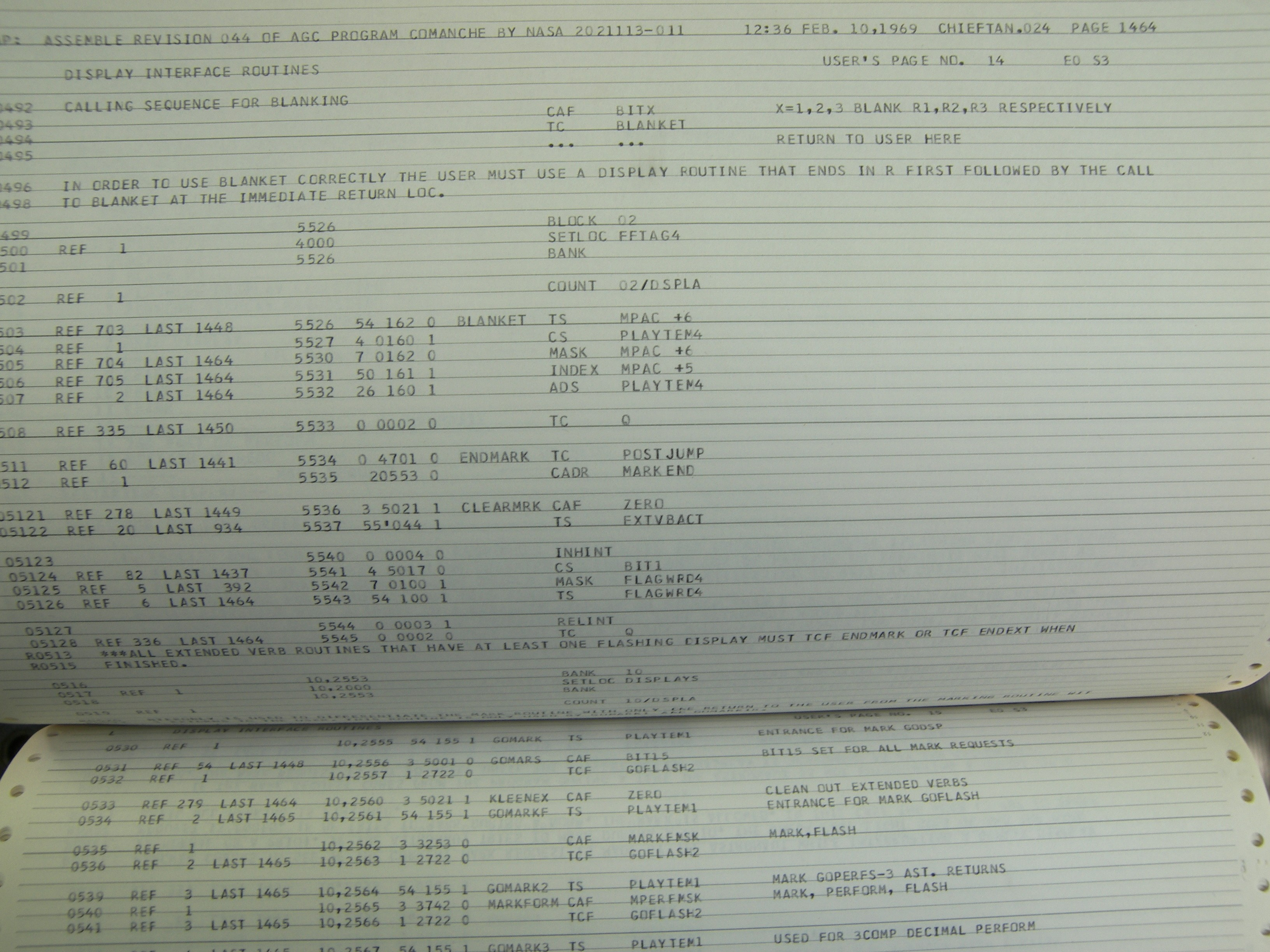 tiny part of the printout of the AGC source code (contained in one of these listings) for the on board flight software for the Apollo Guidance Computer. Credit: Margaret Hamilton