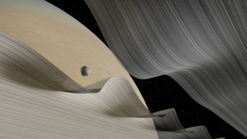 ill's rendition of a low-angled look at Saturn's moon of Daphnis moving through the Keeler Gap. Credit: Kevin GIll/