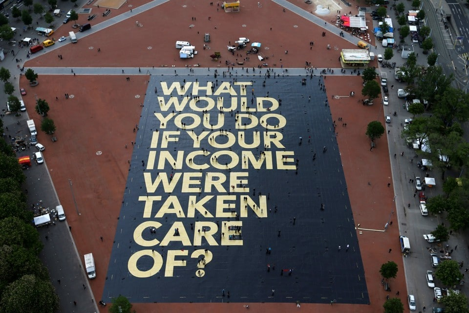 A pro-UBI poster in a square in Geneva, Switzerland. Denis Balibouse / Reuters.