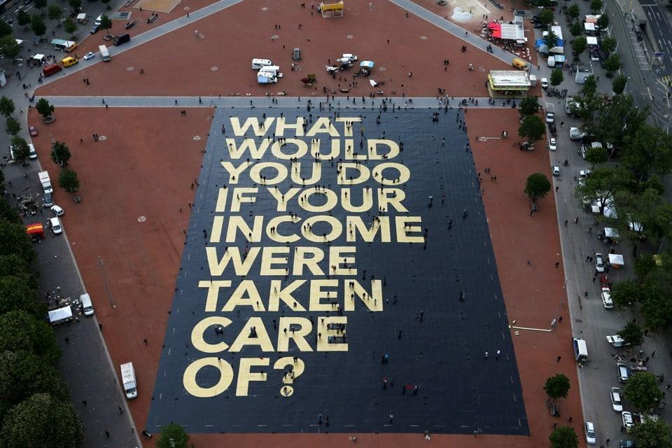 A pro-UBI poster in a square in Geneva, Switzerland. Denis Balibouse / Reuters.