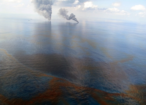 Smoke is visible from controlled burns of the oil released during the Deepwater Horizon oil spill in 2010. This oil well blowout was the largest oil spill in U.S. waters. (NOAA)