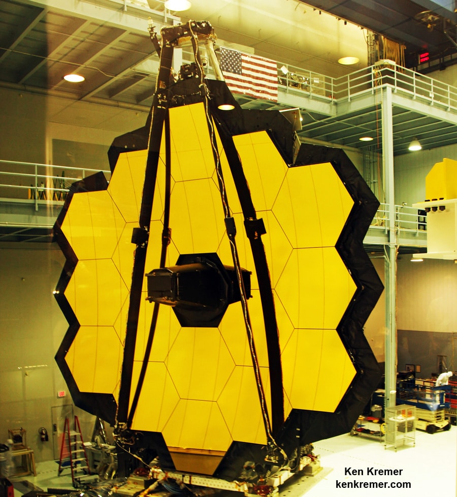 The 18-segment gold coated primary mirror of NASA's James Webb Space Telescope is raised into vertical alignment in the largest clean room at the agency's Goddard Space Flight Center in Greenbelt, Maryland, on Nov. 2, 2016. The secondary mirror mount booms are folded down into stowed for launch configuration. Credit: Ken Kremer/kenkremer.com