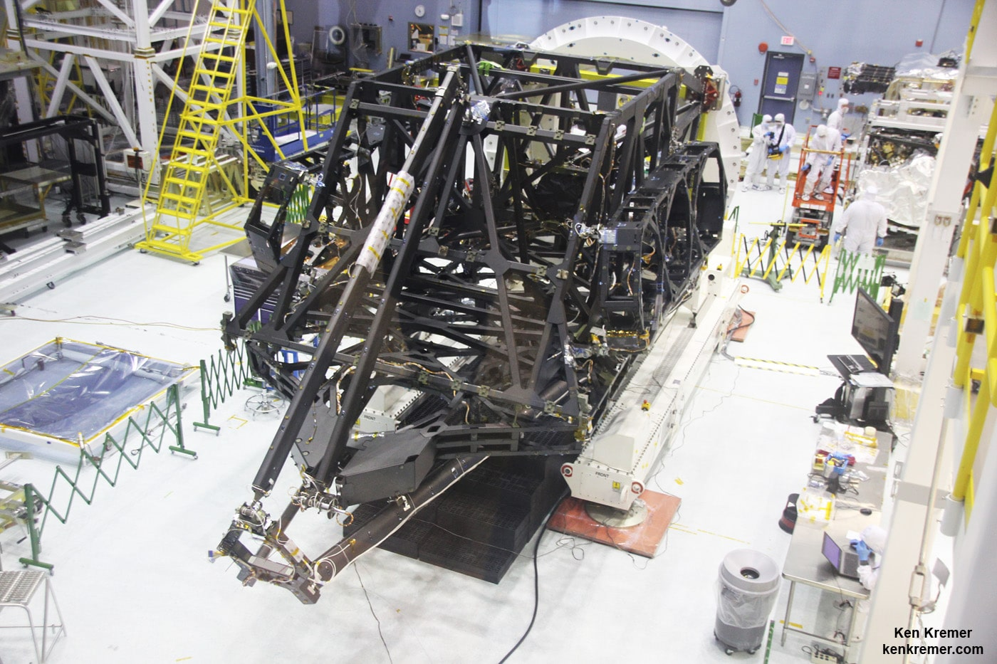 View showing actual flight structure of mirror backplane unit for NASA's James Webb Space Telescope (JWST) that holds 18 segment primary mirror array and secondary mirror mount at front, in stowed-for-launch configuration. JWST is being assembled here by technicians inside the world's largest cleanroom at NASA Goddard Space Flight Center, Greenbelt, Md. Credit: Ken Kremer/kenkremer.com