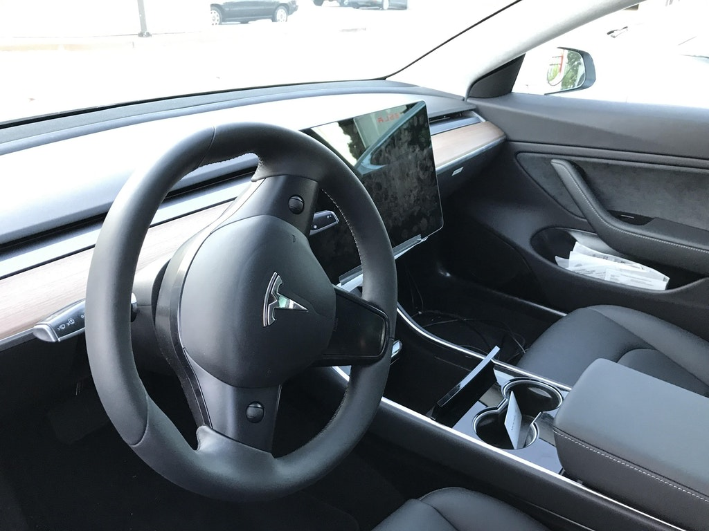 The Model 3's dashboard and steering wheel. Image Credit: You You Xue @youyouxue