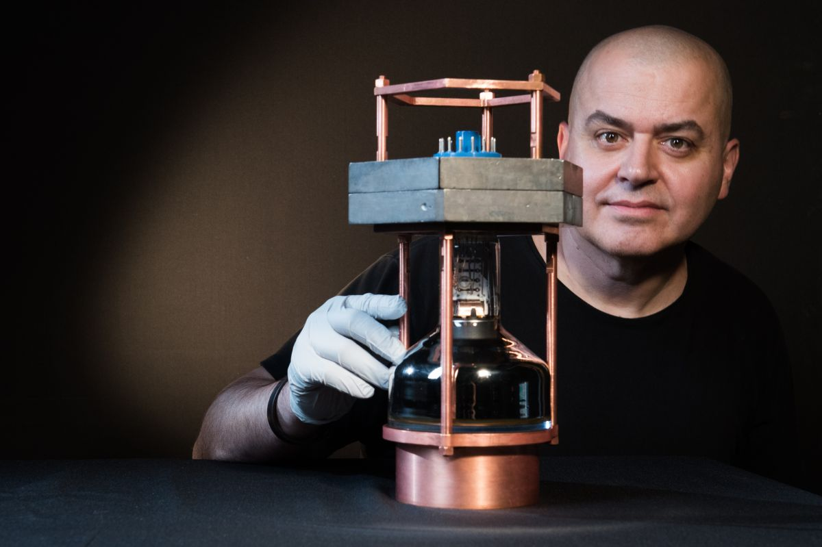 Juan Collar, a professor in physics at the University of Chicago, with a prototype of the world's smallest neutrino detector used to observe for the first time an elusive interaction known as coherent elastic neutrino nucleus scattering.