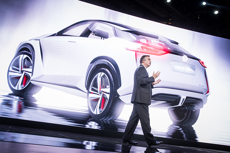 Daniele Schialli unveils the Nissan IMx concept, which will be a singing electric car feature, at the Tokyo Motor Show.