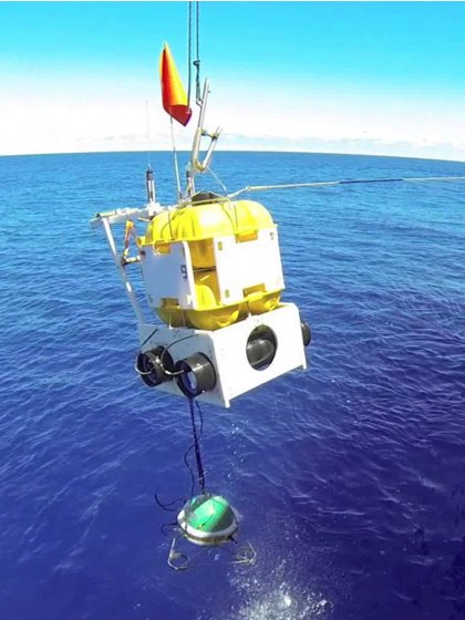 An Ocean-Bottom Seismometer being dropped into the sea, where it measured Earth's hum from the ocean floor. Image credit: RHUM-RUM experiment/Meteor Cruise