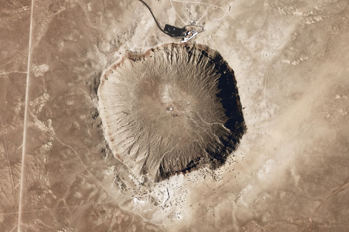 Space-based image of an extraterrestrial crater. This research shows that the building blocks of life could form in inhospitable vacuum conditions like these.