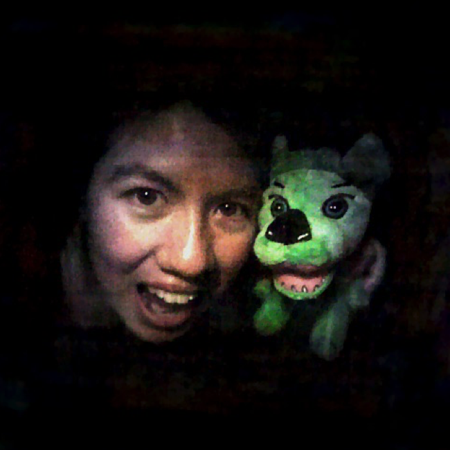 A 3D image of a woman and a green stuffed animal, created by the lensless camera DiffuserCam.