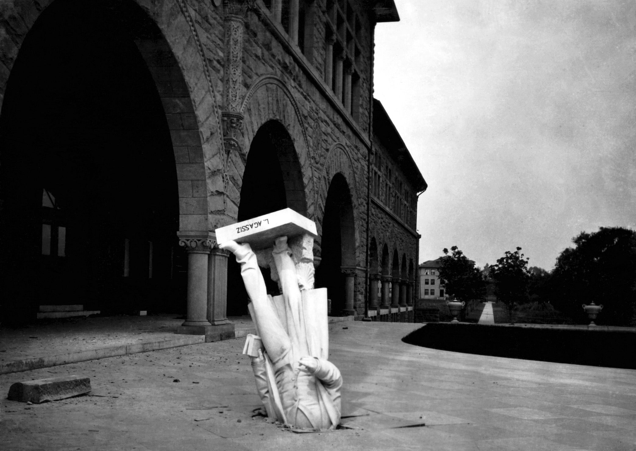 A statue of Louis Agassiz upturned on the Stanford University campus during a 1906 earthquake.