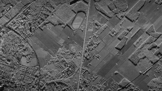 A grayscale, high-relief landscape image captured by a synthetic-aperture radar satellite, such as the ones that will be in ICEYE's satellite swarms.