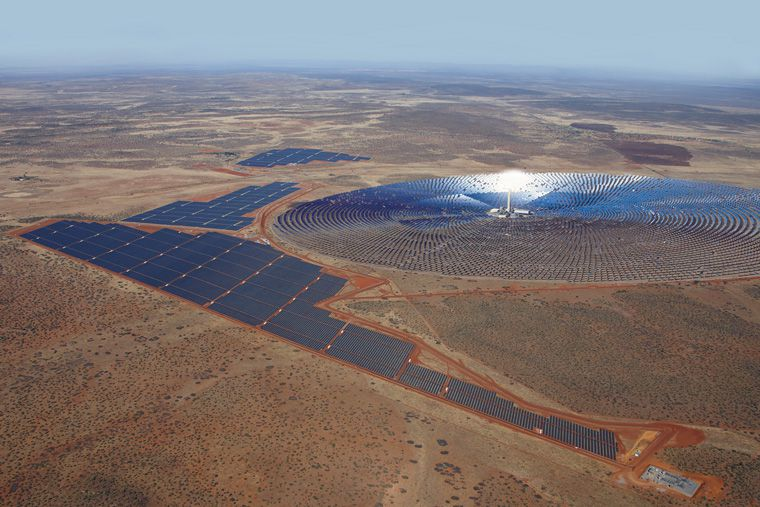 SolarReserve's Redstone molten salt project in Africa, an immense field of mirrors arranged in a circle on reddish dirt.