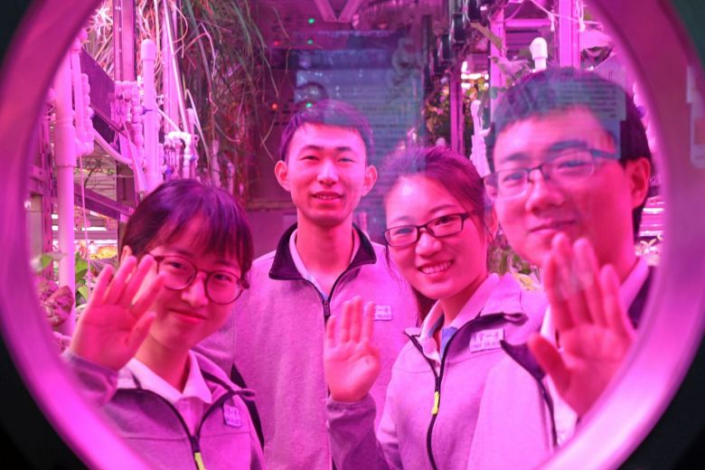 Four students faced the challenges of 200 days in the Lunar Palace. Image Credit: AFP