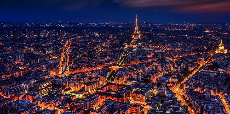 The city of Paris and the Eiffel tower, brightly lit in yellow and orange at night. Soon none of these lights will get their electricity from coal-fired power plants.