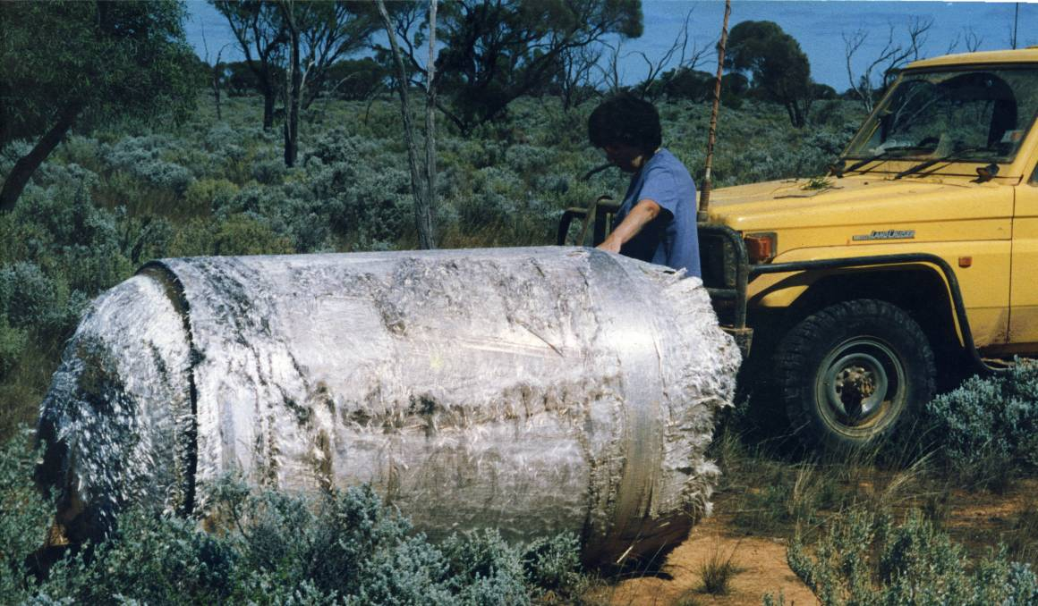 A woman, Pauline Grewar, examines a piece of the crashed Skylab space station on her property in 1979. Scientists have assured that the odds are slim that China's Tiangong-1 will hit any people or property.