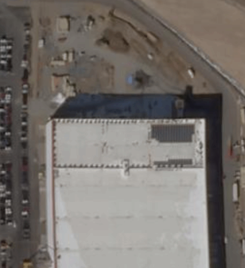 Aerial image of Gigafactory 1 in Nevada showing the small section of solar panels. Image Credit: Building Tesla