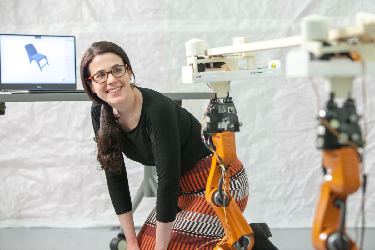 This is Adriana Schulz pictured with the hardware/software workflow. Image Credit: Jason Dorfman, MIT CSAIL