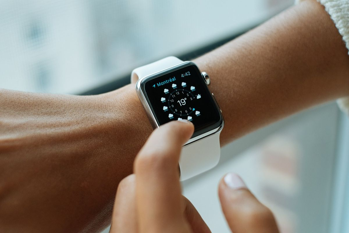 A person's wrist as they check the weather on a smart watch. As more internet of things devices like this come online, we may need a new frequency range to support them.