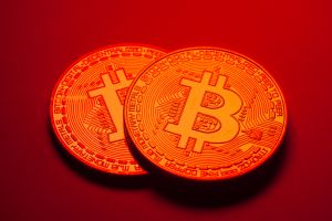 Bitcoin blockchain cryptocurrency coins on a hot red background