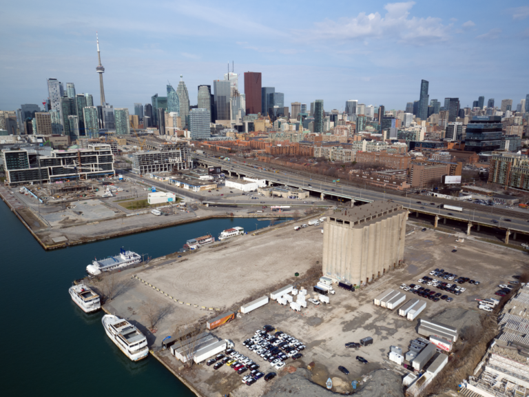 The Eastern waterfront, future site of the Toronto smart city project, today: mostly empty industrial lots with a few old concrete buildings, storage containers, and parked cars.