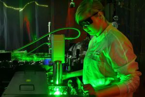 A researcher stands at an ultrafast electron camera that recorded motion in electrons.