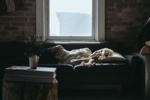 A sleeping woman on a sofa who may have taken sleeping pills to aid her slumber