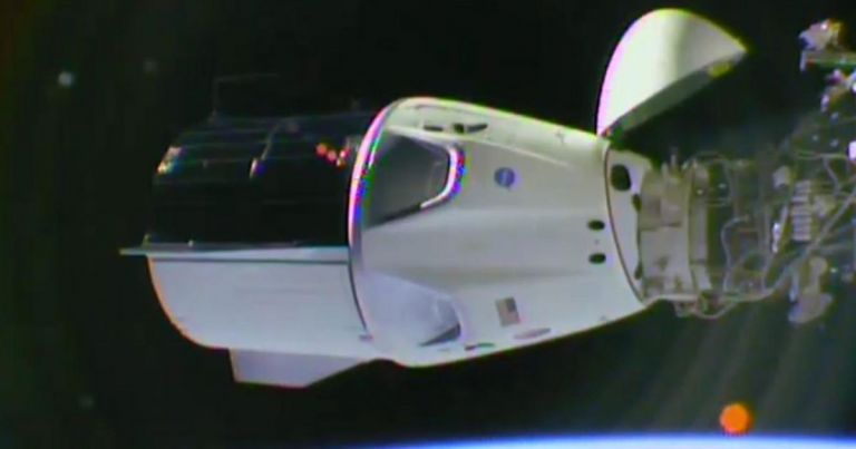 The Crew Dragon docking autonomously with the ISS