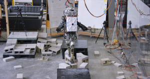 In IHMC Robotics' new video, its humanoid robot Atlas autonomously traverses suspended wooden planks and wobbly cinder blocks.
