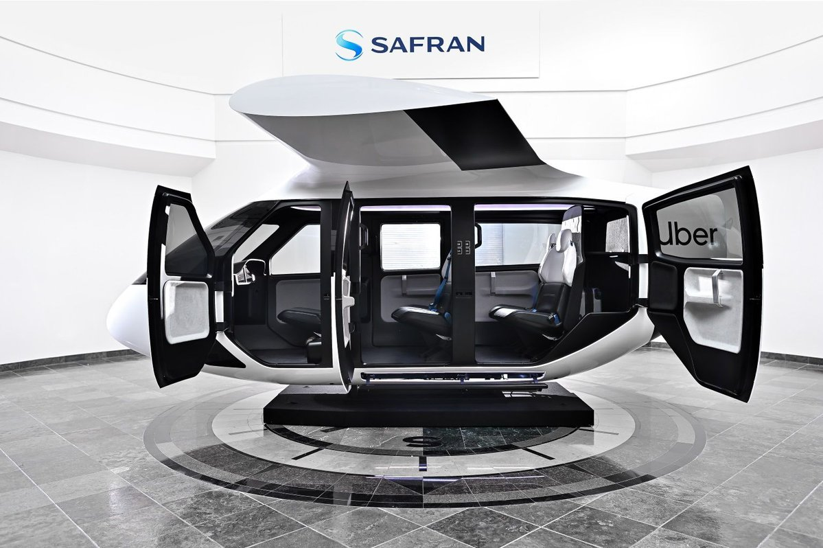 Uber Air has unveiled the first full-scale mock-up of one of the flying taxis it hopes to have ferrying passengers across the skies by 2023.