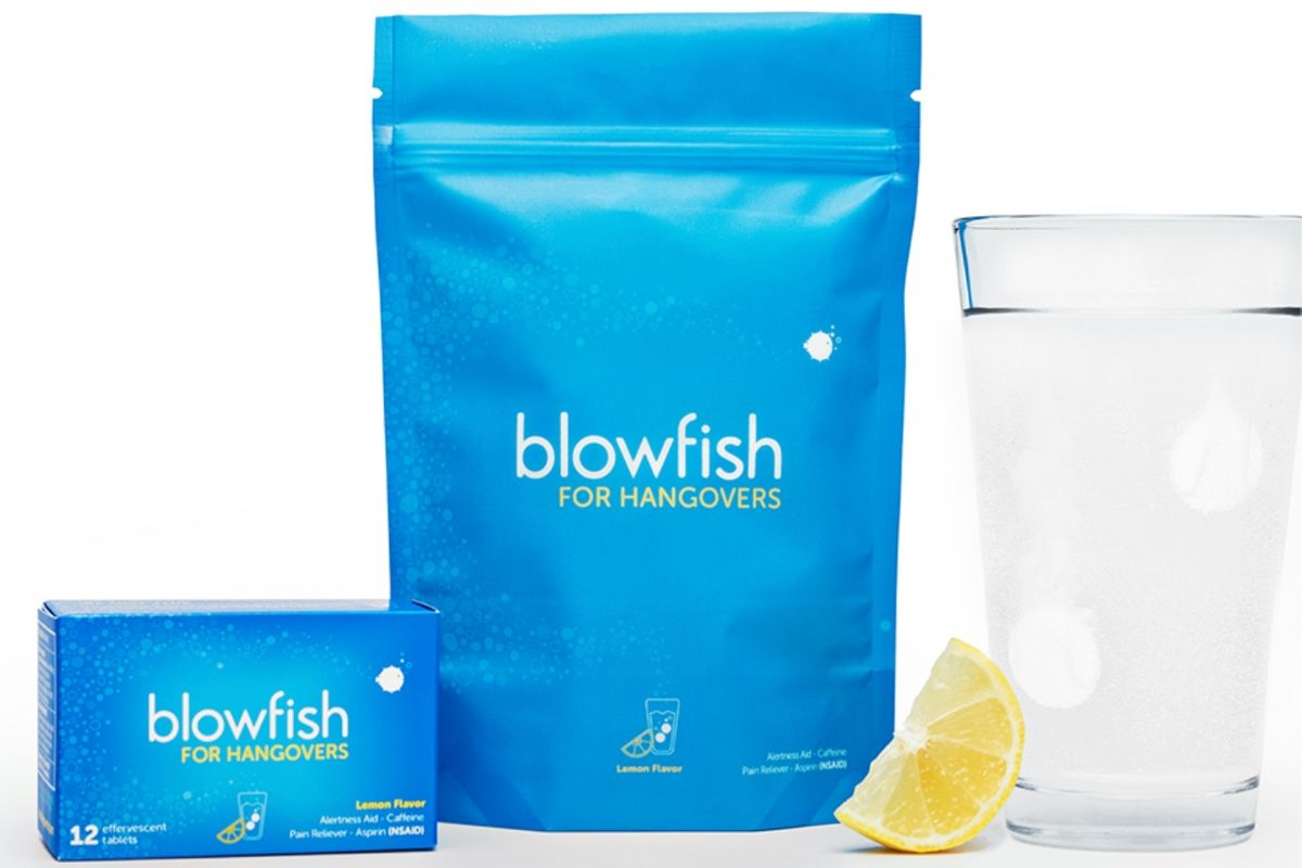 A blue bag of Blowfish for Hangovers next to a glass of water and a lemon slice.