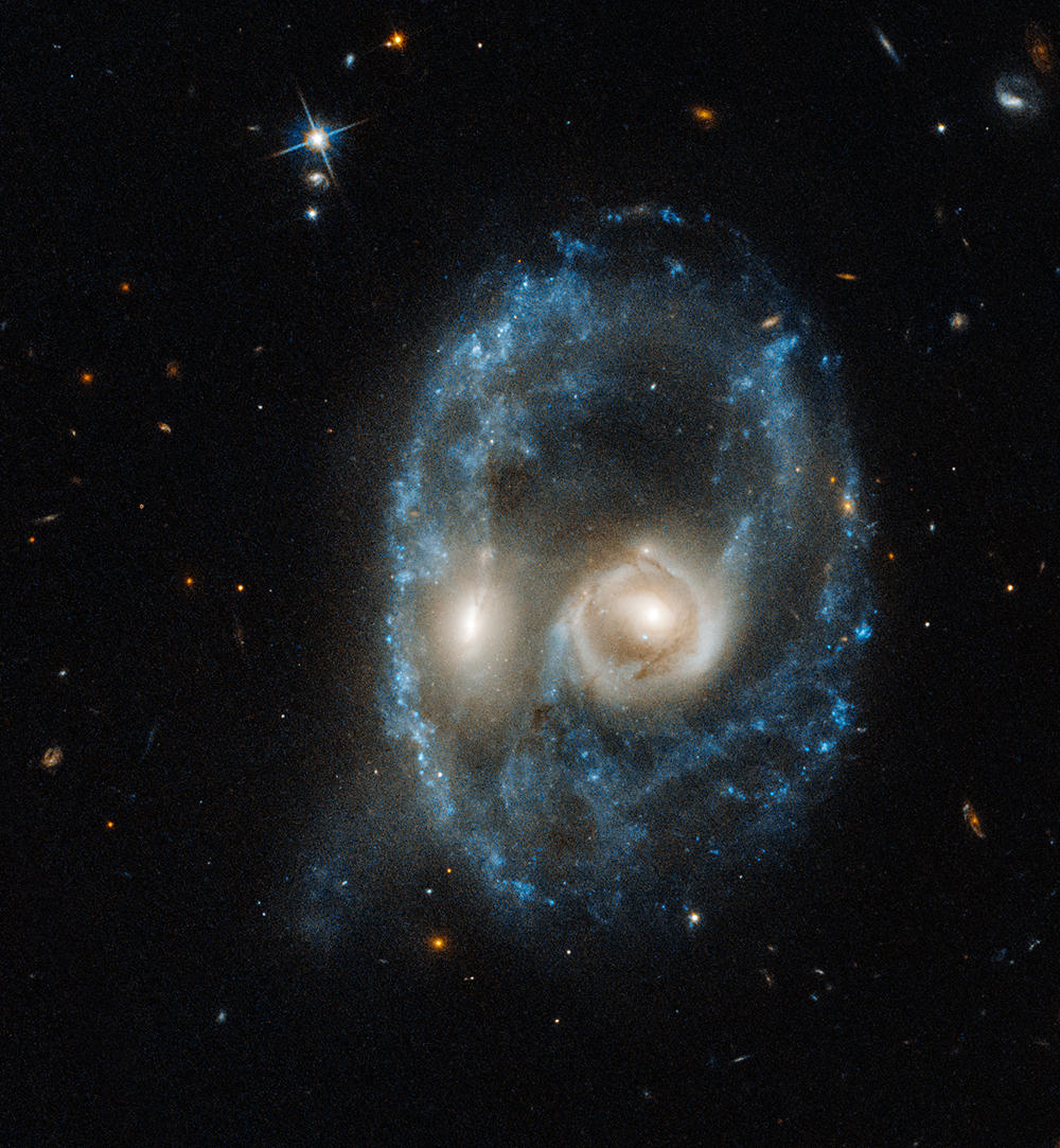nasa-halloween-colliding-galaxies-ghostly-face