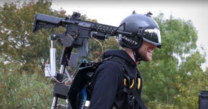 Gravity Industries added a shoulder-mounted toy rifle to its Iron Man-style flying jet suit, and then took it for a spin above a parking lot.