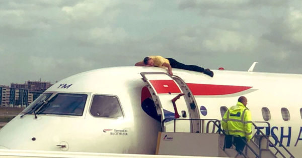 A climate protester just glued himself to the top of an airplane