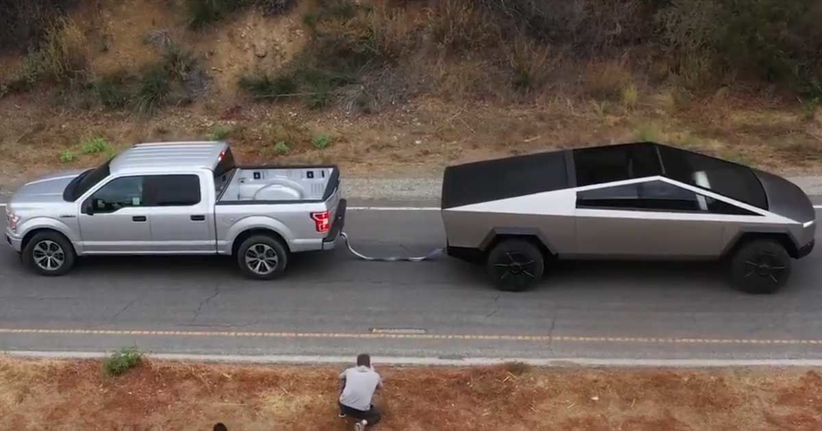 In a video uploaded to Twitter on Sunday by Tesla CEO Elon Musk, a Cybertruck effortlessly pulls a Ford F-150 pickup going the other way — and uphill.