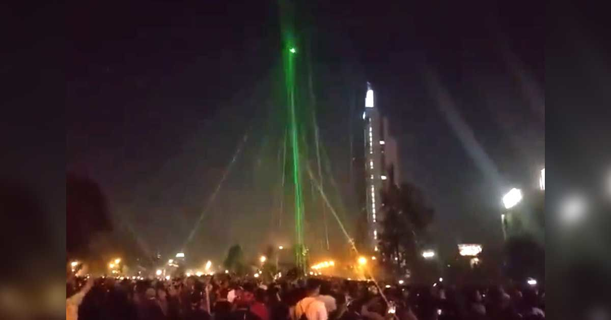 Watch Protestors Kill a Drone Using Hundreds of Laser Pointers