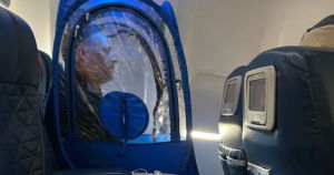 US business man and certified genius Rick Pescovitz was seen wearing a personal, transparent tent in a window seat on a flight to avoid the coronavirus.