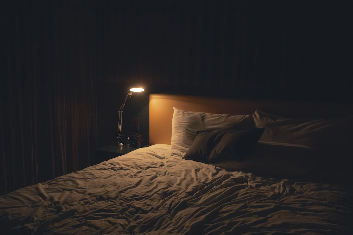 bed with pillow and night light